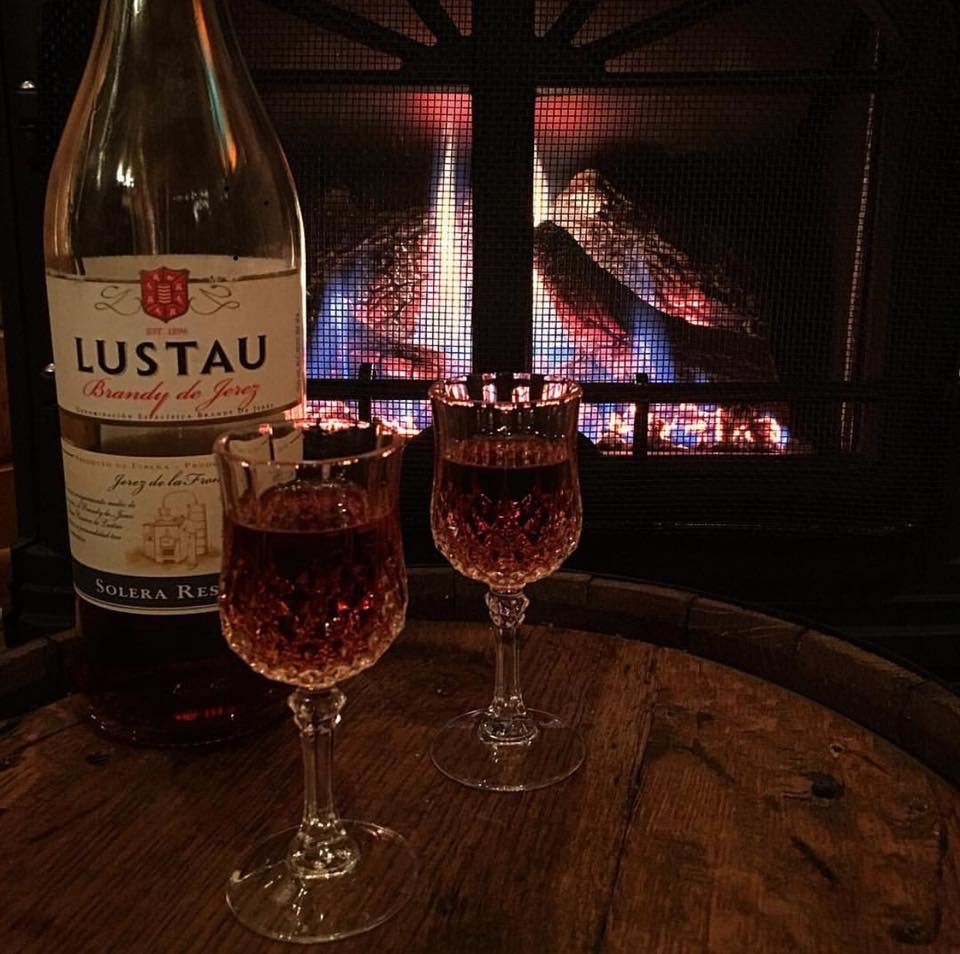 Enjoy a nightcap in front of our cozy fireplace